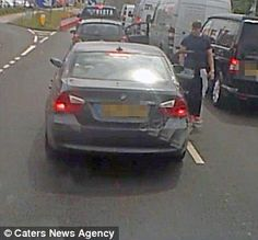 Having come to a standstill, the driver of the Corsa jumps out of his vehicle to confront his fellow motorist