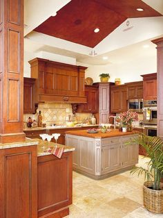 Cherry cabinets vanilla slate flooring and gold granite countertops