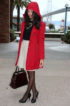 A red Michael Kors trench coat like this would add some cheerful color on a cold fall day!