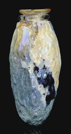 A ROMAN AMBER GLASS DATE FLASK CIRCA 1ST-2ND CENTURY A.D.