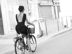 Girl with a dress on bicycle.... the most lovely thing to see moving along the streets. Paris, photo: Ludwig Haskins