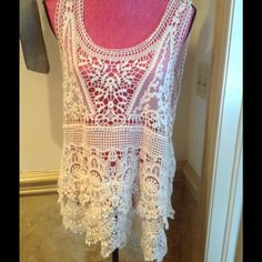 """Stunning crocheted tank top in cream So beautiful. Choose a pretty color cami to wear underneath.  Measures 19"""" across and 27"""" long. Simply Noelle Tops Tank Tops"""
