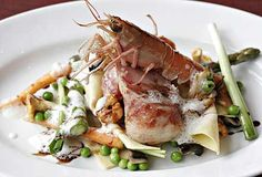 Rabbit on a bed of open lasagne of sautéed mushrooms, crisp broad beans and asparagus, topped with a roasted langoustine.