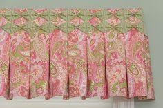 """Small box pleats with sashes 2 sewn into the pleats and then pulled into """"bows"""" across the top.  Adorable!"""