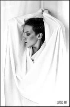 Annie Lennox photographed by Jill Furmanovsky, courtesy of Rockarchive UK, 1983.  The shoot was in her hotel room during an Eurythmics tour.  Annie did her own make-up and the prop was a bed sheet.