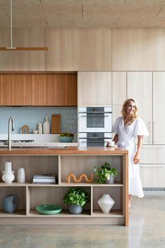 A WWII Queenslander takes away to add more space | Inside Out Geometric Side Table, Timber Kitchen, Rustic Wine Racks, Queenslander, Indoor Outdoor Living, Kitchen Cabinetry, Wood Table, White Walls, Kitchen Interior