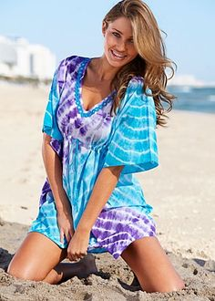 Tie Dye Cotton Tunic $29  Mirrored discs decorate the plunging neckline of this easy fitting cover-up.