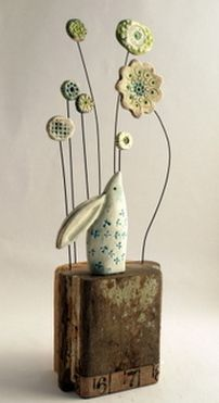 hare and flowers shirley vauvelle click the image or link for more info. Driftwood Projects, Clay Projects, Rock Crafts, Clay Crafts, Biscuit, Bee Creative, Ceramic Houses, Wooden Houses, Pottery Animals