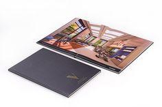 Book para empreendimento imobiliário alto padrão. Capa em capa dura com revestimento especial e hot stamping.