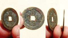 Obverse side of a 'Kang Xi Tong Bao' (康熙通寶) 1 cash coin cast during the reign of Emperor Kangxi (1661-1722 AD). The reverse side of this coin features the mint name in Manchu (left side) and in Chinese (right) with the Chinese character 'Yuan'(原), indicating this coin was cast at the 'Taiyuan' Mint located in Shanxi Province. Both sides of this coin still bear the original filing marks indicating this coin was in general circulation a very short time.  28mm in size; 5 grams in weight…