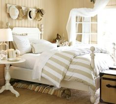 Hats above the bed! Cute idea
