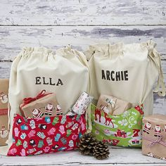 Love these personailised Christmas sacks with the pockets in a vintage fabric