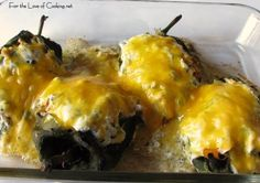 Chicken Stuffed Pasilla Peppers with Cilantro Lime Sour Cream and roasted Green Onion