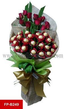 http://yourflowerpatch.com/arrangements/ferrero-rocher-arrangement Check us out at http://yourflowerpatch.com/