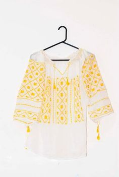 Romanian ethnic white blouse with yellow handmade embroidery via Etsy