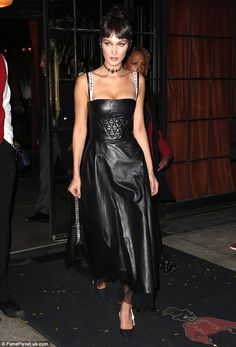 All eyes on her:Bella Hadid donned a stunning lingerie-inspired Christian Dior gown for the French fashion house's book launch in Manhattan on Tuesday