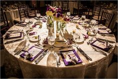 Gorgeous wedding table setting. with brighter flowers and maybe purple sashes on chairs