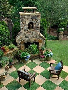 Like the idea of the plant in the fireplaces in the dead of summer when it's too hot to have a fire. Also love the 'tile' look on the lawn!