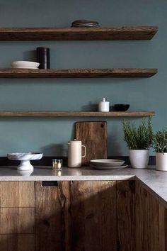 wood shelving + blue walls