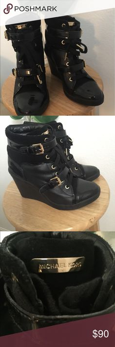 Michael Kors Leather Wedge Sneaker Lace Up Booties Very comfortable. An all black bootie with gold accents. It dresses up any plain old outfit because it's such a statement piece. Good condition. I usually wear a size 7 1/2 - 8 but this fit me just fine once I tighten it. No box. Michael Kors Shoes Ankle Boots & Booties