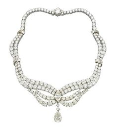 A DIAMOND NECKLACE   Designed as a brilliant-cut diamond swag gathered by a marquise-cut diamond, suspending a detachable pear-shaped diamond, to the baguette-cut diamond scroll spacers, mounted in platinum, 40.5 cm inner circumference