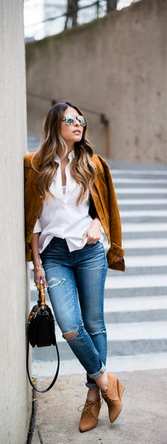 The Girl From Panama 'It Blogger' Pam Hetlinger looks amaze in her Caramel colored wedge booties paired with a coordinating jacket and lightly ripped jeans. This is winter style to covet people! http://ninashoes.com/angeline-caramel-milan-waxy--19031?c=904&utm_source=Pinterest&utm_medium=Social%20Media%20Campaign&utm_term=Winter%20Style&utm_content=Pam%20Hetlinger%20Angeline%20Camel%20Winter%20Style&utm_campaign=Angeline