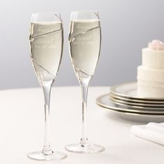 $49.95 per pair - Platinum Swirl - Genuine platinum winds its way around the hand-blown glass bowls of these sophisticated, graceful long-stemmed wedding champagne flutes. From Exclusively Weddings.