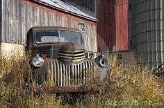 old barn silo pictures | Old farm truck quietly sitting by the barn and silo.