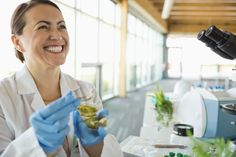 Smiling botanist working in laboratory