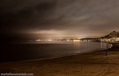 Marbella and beach on a cloudy night