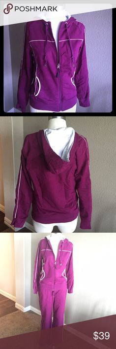 """Danskin Hoodie Jacket Dark fuchsia color. White piping along trim. Pockets on sides. Excellent condition. No stains, holes, or fraying. Size Medium (8-10). Size Large Pants (12-14) also available in a different listing.  Approximate Measurements (unstretched, measured flat when zipped)  Bust - Armpit to Armpit - 18"""" Waistband - 17"""" across Danskin Tops Sweatshirts & Hoodies"""