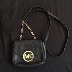Black Leather Small Michael Kors Crossbody 100% Authentic Michael Kors small black leather crossbody bag. Super elegant looking and in good/great condition! No signs of wear. Goes with everything and fits more than meets the eye! Retails $148   *** Interested in more than one of my items??? I'd love to make you a bundle deal, just message me :) Michael Kors Bags Crossbody Bags