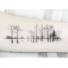 Water forest tattoo on the inner forearm. Tattoo artist: Banul