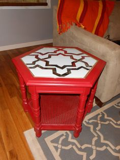 i repainted this table and redone the underneath of the glass top with tape and spraypaint for a frosted look