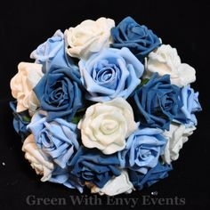 blue and white bouquet  the lighter blue with a pastel yellow flower