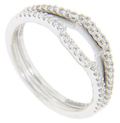 These 14K white gold curved wedding bands are each set with a row of diamonds across the top. Each ring holds a total of .15 carats of diamonds. The bands are photographed here with R2349 (sold separately). Including the curve, each band measures 2.8mm in width. Size: 6 1/2. We can re-size. The bands are frequently purchased as a set for $860.00 but they are also available individually for