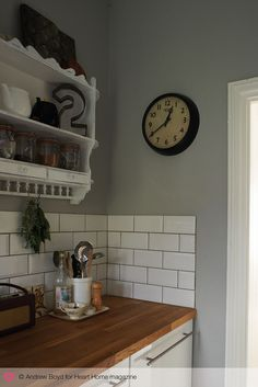 Blue/grey walls with wooden tops and tiles