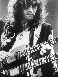 Led Zeppelin's axe-wielder in chief, Jimmy Page, and his famous double necked Gibson