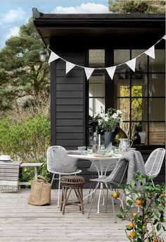 Scandinavian Inspiration | Outdoor Dining | Could this be the perfect spot to enjoy an outdoor brunch? We think so! We love the stripey cushions...they add a cosy feel to this setting...The chairs add a stylish yet chic edge to this scandi vibe! Do you want to recreate this look? Why not shop the look book...