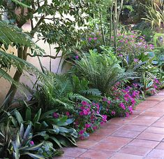 This lush, colorful planting goes beautifully with the tiles and coloration of a Spanish-style landscape. Designed by David Feix of Berkeley, CA, photography by CA designer Michelle Derviss.
