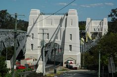 The gothic white towers of Indooroopilly's Walter Taylor Bridge have long been a source of public fascination Local History, Historical Costume, Brisbane, Bridge, Tower, Culture, Costumes, Mansions, House Styles