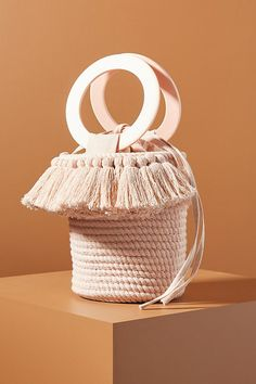 Presented by Anthropologie. In 3 colors. Long ago woven basket bags were simply multi-purpose baskets that were used to carry produce back from the market and store stray items in the household. Diy Purse Organizer, Diy Clutch, Spring Bags, Diy Handbag, Macrame Bag, Laundry Room Design, Basket Bag, Macrame Patterns, Handmade Bags