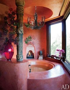 Suspended above the circular bathtub in Will and Jada Pinkett Smith's homenear Calabasas, California , is a vintage Bruce Eicher chandelier from Dana John. The house was designed by Stephen Samuelson with architect Harry Perez-Daple; the interiors are by Judith Lance.
