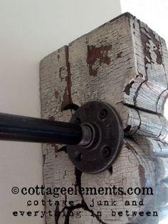 Curtain rod project from corbels and black plumbers piping.  Simple, and inexpensive!