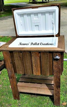 "RECYCLED WOOD PALLETS: We have another cooler ready if anyone is interested. It is an Igloo brand 48 quart size. We have a stained and unstained version. ""Naked"" it sells for $200 and $225 for the stained one. The dimensions are 30"" x 21"" x 37"". They all come with a towel/utensil hook, a bottle opener, and a tap on the side for emptying the water. Message us if you are interested in ordering one of these. Item # 595"