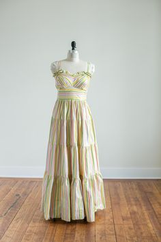 Vintage 1940s 1940's Long Cotton Colorful Cream, Pink, Green, Yellow Candy Striped Full Length Summer Dress with Bows and Ruffles by MsMalenasVintage on Etsy https://www.etsy.com/listing/399827143/vintage-1940s-1940s-long-cotton-colorful