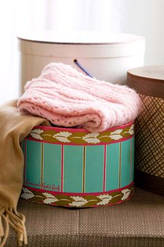 Before you toss that vintage box that's been collecting dust in your basement, give it a good cleaning and find a new purpose for it. Storing out-of season scarves in hatboxes not only keeps unused items out of sight, but also adds a decorative touch to the closet.