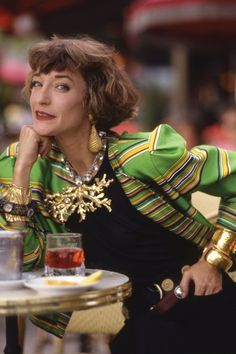 Her clothes vivid with colour, swathed in ethnic jewels, chic hats tipped on her short hair - Loulou de la Falaise was the essence of an English eccentric