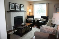 Small TV room done in BM Natural Linen. Sofa from Sears Whole Home. Coffee table from Debbie Travis. Drapery from Bouclair. Pillows from Bouclair and Pier One. Lighting from Homesense. Photos taken by moi. Fireplace painted in BM Cloud White. Rug from Lowes. Leather Chairs from The Bay. small space for sis