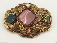 Vintage style antiqued gold tone leaf brooch with inset stone and faux pearl
